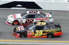 Feb 22, 2014; Daytona Beach, FL, USA; NASCAR Nationwide Series driver Brad Keselowski (22) and NASCAR Nationwide Series driver Ryan Seig (33) during the DRIVE4COPD 300 at Daytona International Speedway. Mandatory Credit: Jasen Vinlove-USA TODAY Sports