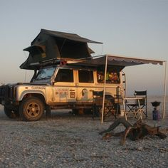 Perfect overland setup, Land Rover defender 110, roof top tent, awning with a set of chairs to enjoy an afternoon bevy! #expeditionreport #adventureeverywhere #expedition #expo #overland #toyota #tacoma #nissan #jeep #hummer #h1 #h2 #h3 #fj #fj40 #fj60 #fj80 #landrover #landcruiser #homeiswhereyouparkit #chevy #4x4 #4wd #ih8mud