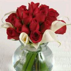 Centerpieces red roses with white Lilies