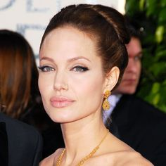 """2007 For the Golden Globes, the A Mighty Heart star (and mom to the newly-adopted Pax) rocked a sleek bouffant updo. """"€œAngelina loves wearing her hair away from her face,""""€ hairstylist Ted Gibson has said."""