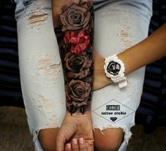 Tattoo black flowers red heart female arm