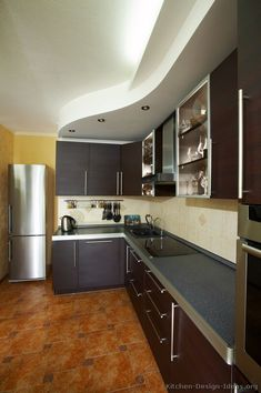 #Kitchen Idea Of The Day: Modern Dark Espresso Kitchen With Lovely Curved  Ceiling Soffit.