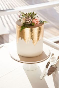 How fabulous is this wedding cake with the Gold Leaf detailing