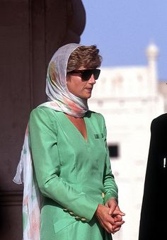 Princess Diana respectfully covering her head during a visit to a mosque in Lahore