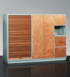 Le Corbusier and Pierre Jeanneret; Wood and Lacquer Duoble-Faced Cabinet, 1927.