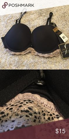Marilyn Monroe Push Up Bra 34B NWT Marilyn Monroe Push Up Bra in black with beige lace trim on bottom. Size 34B.  Two hooks.  Smoke free home.  Never worn.  Will combine shipping.  No trades.  Thanks for looking. Marilyn Monroe Intimates & Sleepwear Bras