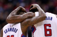Jamal Crawford and DeAndre Jordan of the Los Angeles Clippers embrace during the final minute against the Golden State Warriors in Game Five of the Western Conference Quarterfinals during the 2014 NBA Playoffs at Staples Center on April 29, 2014 in Los Angeles, California. The Clippers won 113-103. (Photo by Stephen Dunn/Getty Images)