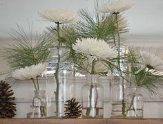 white flowers in vases with touch of greenery