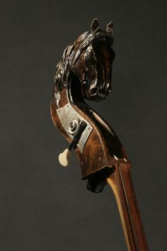 Morin Khuur (Horse-head-fiddle) – The most ancient musical instrument of the Mongols is the morin khuur, invented during the Hun period over 2000 years ago. When Mongolians were an entirely nomadic nation, the horse was their basic means of transport, as well as man's best friend. Many songs and poems were written extolling the horse. There are a number of legends about how the morin khuur was first created, all based on a man's love for a dead horse.