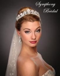 bridal.updos+with+cathedral+veils+and+feather+headpiece | Symphony Bridal Crown 7523CR