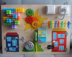 "Items similar to Busy Board ""Micro house"", Activity Board, Sensory Board, Montessori educational Toy, Fine motor skills board for toddlers & babies on Etsy Farm Activities, Activities For Girls, Infant Activities, Diy Busy Board, Busy Board Baby, Diy For Kids, Crafts For Kids, Busy Boards For Toddlers, Sensory Boards"