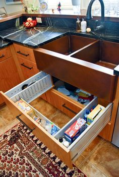 http://www.pinterhome.com/category/Utility-Sink/ This is such a good idea for that unused space under the sink!