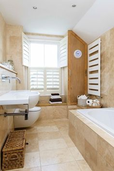 Small space? Tile it all = Beach Style Bathroom by Whitstable Island Interiors