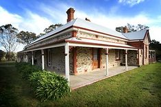 Country Australian Colonial - wide verandahs, doors leading direct to the verandahs, simple lines
