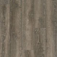 Shop Style Selections 6.14-in W x 3.96-ft L Park Lodge Oak Embossed Wood Plank Laminate Flooring at Lowes.com