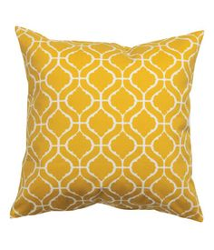 Cushion cover in patterned cotton twill with a concealed zip.