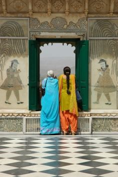 2 Indian tourists. I wonder who is depicted on the walls? Udaipur, India
