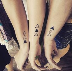 Her sibling tattoo. 7 triangles, the coloured one is for said sibling. (On the side of their left wrists) 1. Charlie 2. William 3. Louis 4. Sebastian 5. Jessie 6. Harlie 7. Frankie