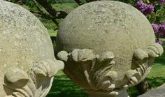 """A pair of weathered sandstone finials carved as acanthus clasped balls on square tapered bases. These are sizeable gate pier finials which would be suitable for a large gateway. They are from Northern India and are carved to a traditional English design using a durable sandstone similar to York stone.  Modern  16"""" x 16"""" x 27"""" high  950 for the pair"""