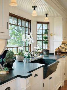 Traditional Kitchen with Hardwood floors, Slate counters, High-arc side sprayer bridge kitchen faucet, Slate, flush light