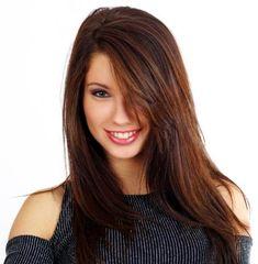dark brown hair with dark red highlights.