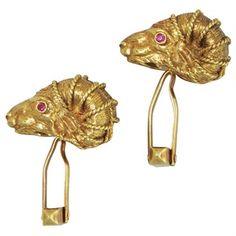 18K Yellow gold rams head cufflinks featuring rubies.