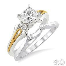 Honor your sweetheart for being part of your life with this remarkable two tone diamond wedding set. Crafted in glinting 14 karat yellow and white gold the engagement ring holds an alluring 1/3 ct prong set princess cut center stone diamond accented by 4 sparkling round cut prong set accented diamonds. The wedding band sparkles with 2 round cut diamonds in prong setting. Total diamond weight for the set is 1/2 ctw.