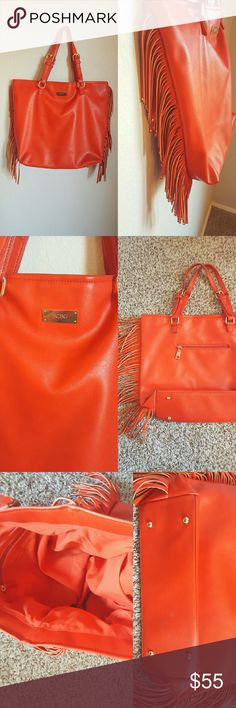 "{BCBG} Paris Burnt Orange Fringe Tote Bag Height: 13.5"" Length: 16.5"" Depth: 4"" Strap: 8""  This bag is PERFECT for Fall <3 Cute gold accented fringe on sides, zip pocket on the back, inside compartments, and magnetic closure. In gently used condition. Outside and inside are clean and bag is undamaged. Don't miss out on this beautiful bag!   *No trades *Bundle to save 10% *Reasonable offers considered BCBG Bags Totes"