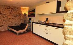 cozy living room with authentic stone wall in apartment Il Rosmarino - agriturismo Verdita   www.verdita.com