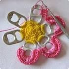 Cute crochet project using pop tabs. IndyUpcycle has a big jar of pop tabs. Crochet a Flower With Soda Pop Can Tabs . A good introduction to recycled crafts, this crochet flower can be made into a Christmas tree ornament, a brooch or incorporated into a l Yarn Projects, Crochet Projects, Sewing Projects, Knitting Projects, Crochet Crafts, Yarn Crafts, Diy Crafts, Recycled Crafts, Pop Top Crafts