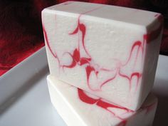Wispy and delicate red lines in a pure white soap.  Beautiful...