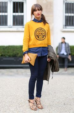 Yellow and blue almost always make stunning combination. The same holds true for combining sporty and preppy pieces just as long as you don't overdo it. Take this a look at this street style look we spotted in Paris.