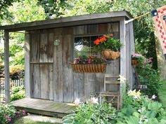 The beautiful patina of barn wood gives this rustic potting shed that always-been-there look. The wood and roofing material came from a century-old barn on the family farm, and the windows were collected from curbside.