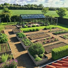 If you have the space why not have a fantastic vegetable garden like this? The raised beds and gravelled paths look so neat and uniform. Love it! #gardengoals