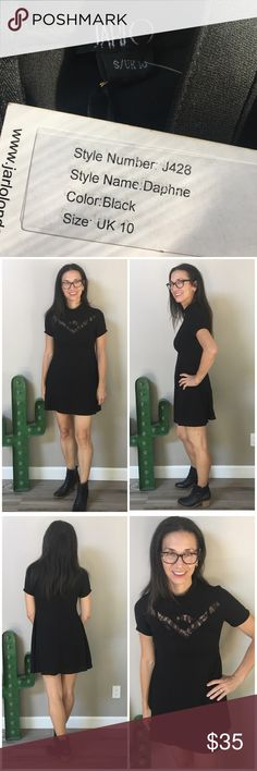 """NWT Jarlo London high neck lace inset minidress Black isn't basic when you are wearing this stunningly chic British high end dress designer Jarlo London short sleeve black minidress. Cute for cocktails or just date night. Flippy Skater skirt. Elegant high neck. Great seaming. Full length back zipper. Awesome lace inset detailing. UK women's size 10 = US women size 6, but I think this runs a bit small & is more suited to a 4. Measurements when laid flat are: waist 14"""", pit to pit 16"""", length…"""