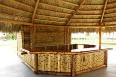 Big Kahuna Tiki Huts completed a project for a resort on the West Coast of Fl in which we built a tiki hut and a tiki bar. Bamboo Shop, Bamboo Bar, Bamboo Restaurant, Restaurant Design, Bamboo House Design, Bamboo Building, Tiki Bar Decor, Bali Huts, Bamboo Structure