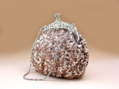 On Sale 35% OFF --Sparkly Peach Wedding Purse Evening Clutch. $30.50, via Etsy.