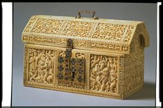 The Robinson Casket, made in Kotte, Sri Lanka ca 1557. Carved ivory with silver gilt hinges and gold filigree lock and handle set with sapphires. The 'Robinson Casket' is one of a group of at least nine solid ivory caskets made in Kotte, Ceylon (now Sri Lanka), and sent by the kingdom's rulers to Portugal as diplomatic gifts. It is believed to have been made about 1557 to commemorate the King of Kotte's conversion to Christianity and the birth of a grandson and heir to the King of Portugal.