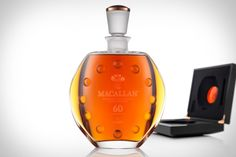 Macallan 60 - A Baller's baller's drink.  It would be cheaper to take shots of liquid gold.  Nice presentation though.