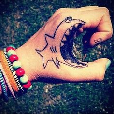 Funny Shark Hand Tattoo tattooideaslive.com #funny #tattoos