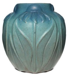 """Van Briggle vase, (United States, Colorado, Colorado Springs, born 1899) ca. 1920s, large form with carved daisy design under a blue and green matt glaze, 9""""h;"""