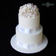 Beautiful white cake by Yummies