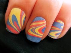 good demo on how to do water marble.  u can also use tape around nails to avoid getting polish all around the nail