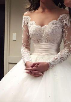 Elegantly unique off-the-shoulder embroidered long-sleeve wedding dress with empire waistline; Featured Dress: Steven Khalil