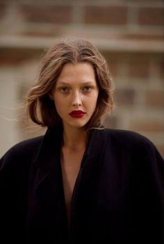 Just windy hair, no makeup-makeup and the best pair of red lips I've ever seen. Plus overcoat size Xtra large!