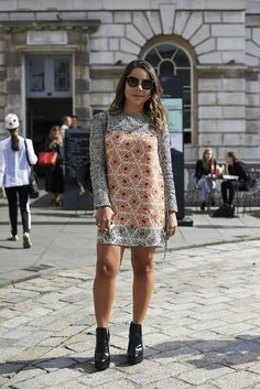 We love the shape of this simple dress, especially when paired with bare legs and boots. #LFW