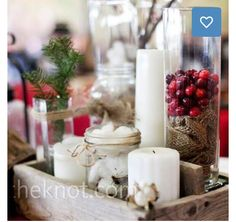 wood box with white candles, red berries, burlap