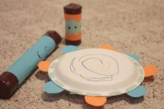 Paper roll maracas and paper plate tambourine.