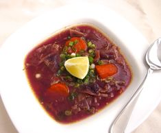 Red Chicken Soup 1 chicken 1 red onion 2 cloves garlic ½ medium red cabbage 2 large carrots 1 tsp white peppercorns (omit for strict AIP) Fish sauce, to taste 1 tsp ginger powder 1 tsp turmeric powder 1 tsp cinnamon powder 1 - 2 tbsp tamarind paste 1 lime Sea salt, to taste ½ pineapple 1 - 2 spring onions