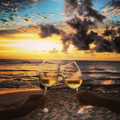 the world is more beautiful with a glass of wine
